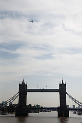 © Licensed to London News Pictures. 21/08/2013. The Catalina G-PBYA waterplane flies over Tower Bridge in London to commemorate the 100th Anniversary of the Circuit of Britain Race when Harry Hawker, the first pilot ever flew around Britain in a waterplane. The Catalina G-PBYA is the oldest air worthy amphibian aeroplane still flying in the UK and was flown today, 21 August 2013 by pilot Jeff Boyling who is attempting to follow the the original 1913 route along the River Thames. Photo credit : Vickie Flores/LNP.