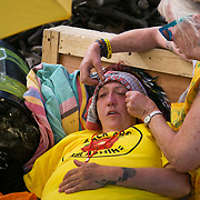13 local activists locked themselves in specially made arm tubes to block the entrance to Quadrilla's drill site in New Preston Road, July 03 2017, Lancashire, United Kingdom. Alana McCullough has been in her lock-on for 15 hours and is struggling. The 13 activists included 3 councillors; Julie Brickles, Miranda Cox and Gina Dowding and Nick Danby, Martin Porter, Jeanette Porter,  Michelle Martin, Louise Robinson,<br /> Alana McCullough, Nick Sheldrick, Cath Robinson, Barbara Cookson, Dan Huxley-Blyth. The blockade is a repsonse to the emmidiate drilling for shale gas, fracking, by the fracking company Quadrilla. Lancashire voted against permitting fracking but was over ruled by the conservative central Government. All the activists have been active in the struggle against fracking for years but this is their first direct action of peacefull protesting. Fracking is a highly contested way of extracting gas, it is risky to extract and damaging to the environment and is banned in parts of Europe . Lancashire has in the past experienced earth quakes blamed on fracking.