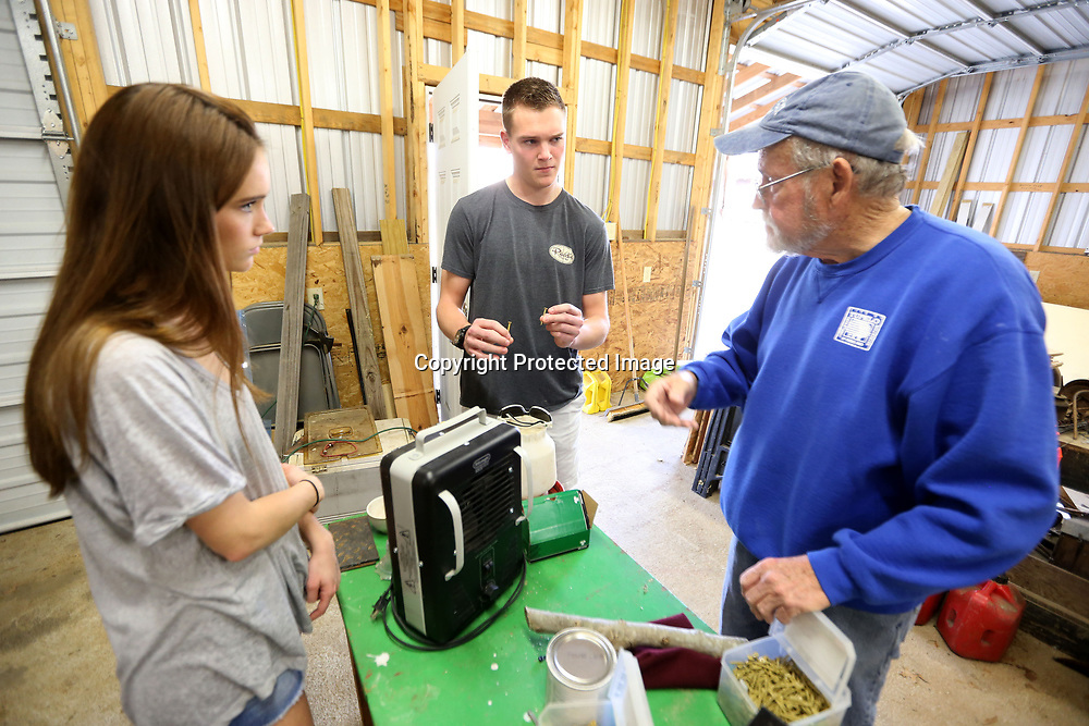 Tupelo High School Seniors Ashton Davis and Reed McNeal listen as Jerry Duckett shows them around the workshop at Oren Dunn in Tupelo as they prepare to start their senior project for a mural that will be placed at the community garden on Spring Street in Tupelo.