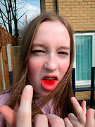 Girl with braces sticking her fingers up