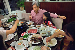 Todd Leong shares dinner with daughter Clarissa Leong, 6, inside their home in Soho, New York, N.Y., Sept. 9, 2011.