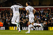 Emmanuel Adebayor of Tottenham Hotspur (left) celebrates scoring his first goal of the game to make it 2-1 on the night with Kyle Naughton of Tottenham Hotspur (right) during the UEFA Europa League match at White Hart Lane, London<br /> Picture by David Horn/Focus Images Ltd +44 7545 970036<br /> 27/02/2014