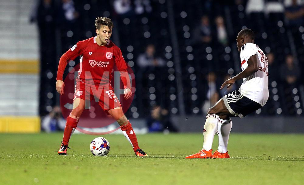 Luke Freeman of Bristol City takes on Dennis Adeniran of Fulham - Mandatory by-line: Robbie Stephenson/JMP - 21/09/2016 - FOOTBALL - Craven Cottage - Fulham, England - Fulham v Bristol City - EFL Cup
