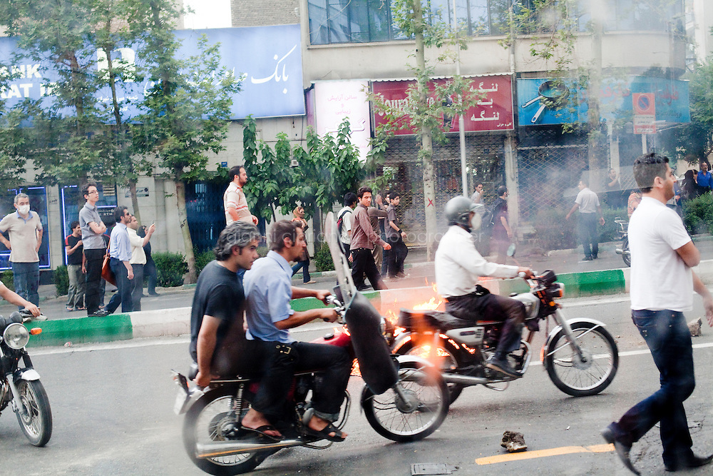 13 June, 2009. Tehran, Iran. Supporters of reformist candidate Mir Houssavi Moussavi occupy some of Tehran's streets, setting fires and throwing stones at the police. Police clamped down on supporters of the opposition candidate, Mir Hussein Moussavi, who said the election was stolen by President Ahmadinejad. Conservative reformist candidate Mir Hossein Mousavi ran against the ultra-conservative current President of Iran Mahmoud Ahmadinejad.<br /> &copy;2009 Gianni Cipriano<br /> cell. +1 646 465 2168 (USA)<br /> cell. +39 328 567 7923<br /> gianni@giannicipriano.com<br /> www.giannicipriano.com