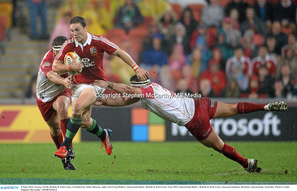 8 June 2013; George North, British & Irish Lions, is tackled by James Hanson, right, and Greg Holmes, Queensland Reds. British & Irish Lions Tour 2013, Queensland Reds v British & Irish Lions, Suncorp Stadium, Brisbane, Queensland, Australia. Picture credit: Stephen McCarthy / SPORTSFILE