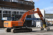 A demolition vehicle gets ready to start demolition work during the AFC Wimbledon Demolition Event, marking the start of building works at the AFC Wimbledon Stadium Site, Plough Lane, United Kingdom on 16 March 2018. Picture by Stephen Wright.