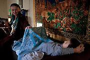 Sonia Khancoshvili wakes up her grandson Bekan (8). Duisi, Republic of Georgia.