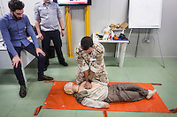"VALLETTA, MALTA - 8 FEBRUARY 2017: An officials of the Libyan Navy simulates a cardiopulmonary resuscitation during a first-aid course held in a container in the hangar of the San Giorgio, an amphibious transport dock of the Italian Navy, in Valetta, Malta, on Febuary 8th 2017.<br /> <br /> As a consequence of the April 2015 Libya migrant shipwrecks, the EU launched a military operation known as European Union Naval Force Mediterranean (EUNAVFOR Med), also known as Operation Sophia, with the aim of neutralising established refugee smuggling routes in the Mediterranean. The aim of this new operation launched by Europe is to undertake systematic efforts to identify, capture and dispose of vessels as well as enabling assets used or suspected of being used by migrant smugglers or traffickers. On 20 June 2016, the Council of the European Union extended Operation Sophia's mandate reinforcing it by supporting the training of the Libyan coastguard.<br /> Thus far, following EUNAVFOR MED operation Sophia's activities, 101 suspected smugglers and traffickers have been apprehended and transferred to the Italian<br /> authorities and 380 boats were removed from the criminal organizations' availability. The Operation has saved 32.081 migrants, among whom 1888 children.<br /> <br /> On February 2nd 2017 Italian Premier Paolo Gentiloni and Prime Minister of the U.N. backed Libyan government Fayez al-Serraj signed a memorandum of understanding on cooperation to combat illegal migration, human trafficking and contraband and on reinforcing the border between Libya and Italy. The following day, as EU leaders meet in Malta for a summit, European Council President Donald Tusk said after talks with Serraj, that ""it is time to close the (migrant) route from Libya to Italy"" and that ""the EU has shown it is able to close the routes of irregular migration, as it has done in the eastern Mediterranean.""  Tusk said the Central Mediterranean route was ""not sustainable either for the EU or for Libya"", where he said"