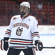 John Stevens #18 of the Northeastern Huskies lines up for a face-off during the game at Matthews Arena on January 18, 2014 in Boston, Massachusetts. (Photo by Elan Kawesch)