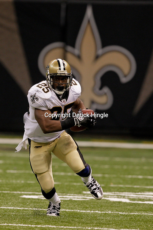 2009 September 13: New Orleans Saints running back Reggie Bush (25) runs after a catch during a 45-27 win by the New Orleans Saints over the Detroit Lions at the Louisiana Superdome in New Orleans, Louisiana.