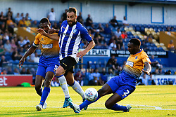 Hayden White of Mansfield Town sticks out a leg to block a shot by Atdhe Nuhiu of Sheffield Wednesday - Mandatory by-line: Ryan Crockett/JMP - 24/07/2018 - FOOTBALL - One Call Stadium - Mansfield, England - Mansfield Town v Sheffield Wednesday - Pre-season friendly