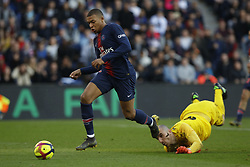February 23, 2019 - Paris, France - KYLIAN MBAPPE beats Nice Keeper during the French L1 football match between Paris Saint-Germain and Nimes at the Parc de Princes in Paris. Kylian Mbappe passed 50 Ligue 1 goals with a double to extend their lead at the top of the table to 17 points. (Credit Image: © Mehdi Taamallah/NurPhoto via ZUMA Press)
