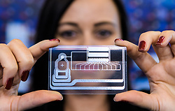 &copy; Licensed to London News Pictures.<br /> 27/06/2017<br /> Emily Lovelock of allpay card manufacturers shows the antenna of a credit card which allows it to use Near Field Communications to make payments at The Money 20/20 Europe exhibition held at The Bella Centre in Copenhagen, Denmark,  June 27th 2017<br /> The Money 20/20 Europe exhibition is the largest FinTech event in Europe and show cases new and emerging technologies in the financial sector<br /> Photo credit should read Ant Upton/LNP