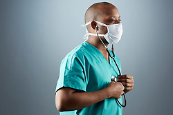 A portrait series representing the intense emotions that Doctors face.  An African American male Doctor wearing a white surgical mask, stethoscope, and green medical scrub suit shown.