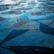 With the rising temperture moving towards spring the frozen layer over the Oslo Harbour cracks and melts. With the ebb and flow of the tide these pieces crack and float freely, battling each other for space.