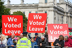 © Licensed to London News Pictures. 01/10/2019. London, UK. Pro-EU protesters with large placards outside Houses of Parliament with thirty days remaining until Brexit Day. It has been reported that Prime Minster Boris Johnson has asked EU to rule out a further Brexit extension as part of a proposed new deal for the UK's departure from the bloc.Photo credit: Dinendra Haria/LNP