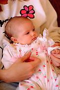 Newborn baby girl age 3 months being held by mother.  Burnsville Minnesota USA