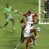 Players battle for the ball during a United Soccer League Pro soccer match between Puerto Rico United and the Orlando City Lions at the Florida Citrus Bowl on April 22, 2011 in Orlando, Florida.  (AP Photo/Alex Menendez)