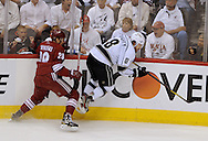 May 13, 2012; Glendale, AZ, USA; Phoenix Coyotes left wing Lauri Korpikoski (28) and Los Angeles Kings defenseman Drew Doughty (8) during the game one of the Western Conference finals of the 2012 Stanley Cup Playoffs at Jobing.com Arena.  The Kings defeated the Coyotes 4-2. Mandatory Credit: Jennifer Stewart-US PRESSWIRE