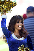 A San Diego Chargers cheerleader waves pom poms during the NFL week 15 regular season football game against the Denver Broncos on Sunday, Dec. 14, 2014 in San Diego. The Broncos won the game 22-10. ©Paul Anthony Spinelli