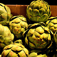 Jumbo Artichokes with Stem in Box at Farmers Market in Vancouver, Canada
