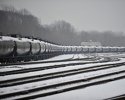 Unattended railroad tank cars displaying US DOT placard number 1267 indicating they are carrying up to 31720 gallons of crude oil each sit on a rail line near First Avenue in Bethlehem on March 3, 2015.