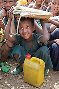Abaythara, Ethiopia - 19.05.16  - Birchiko, a grade one student, stays out of the sun at Abaythara primary school in West Belessa district, Ethiopia on May 19, 2016. The school has 791 students, all of which receive a daily CBM-funded meal. Still lacking water, the school arranged a system by which every student brings 3 litres of water each day -- ensuring the school has enough water. Photo by Daniel Hayduk