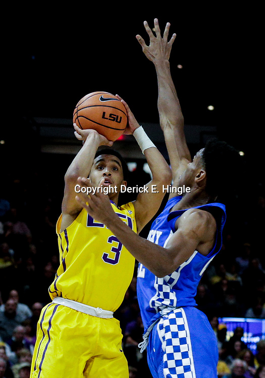 Jan 3, 2018; Baton Rouge, LA, USA; LSU Tigers guard Tremont Waters (3) shoots over Kentucky Wildcats guard Shai Gilgeous-Alexander (22) during the second half at the Pete Maravich Assembly Center. Kentucky defeated LSU 74-71.  Mandatory Credit: Derick E. Hingle-USA TODAY Sports