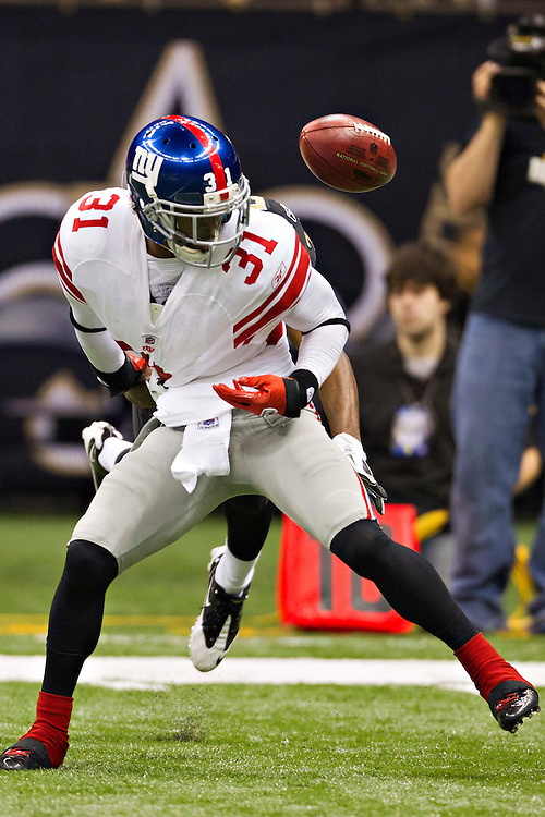 NEW ORLEANS, LA - NOVEMBER 28:   Aaron Ross #31 of the New York Giants has the ball knocked out of his grasp during a game against the New Orleans Saints at Mercedes-Benz Superdome on November 28, 2011 in New Orleans, Louisiana.  The Saints defeated the Giants 49-24.  (Photo by Wesley Hitt/Getty Images) *** Local Caption *** Aaron Ross