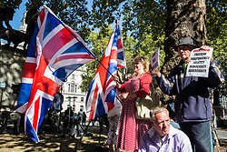 London, UK. 18 September, 2019. Brexit supporters protest outside the Supreme Court on the second day of a hearing to consider whether Prime Minister Boris Johnson broke the law by suspending Parliament in advance of Brexit Day.
