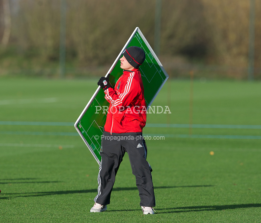 MANCHESTER, ENGLAND - Friday, November 25, 2011: A young Liverpool player struggles to carry the tactics board in strong winds before the FA Premier League Academy match against Manchester United at the Carrington Training Ground. (Pic by David Rawcliffe/Propaganda)