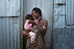 Nanday and her daughter outsides their home..Kroo Bay, Freetown, Sierra Leone.