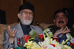 June 16, 2017 - Lahore, Punjab, Pakistan - Dr. Tahir-ul-Qadri Pakistani politician and Islamic scholar of Sufism head of  Pakistan Awami Tehreek (PAT) also the founding chairman of Minhaj-ul-Quran talking to media persons during a press conference against the government at a local hotel. (Credit Image: © Rana Sajid Hussain/Pacific Press via ZUMA Wire)
