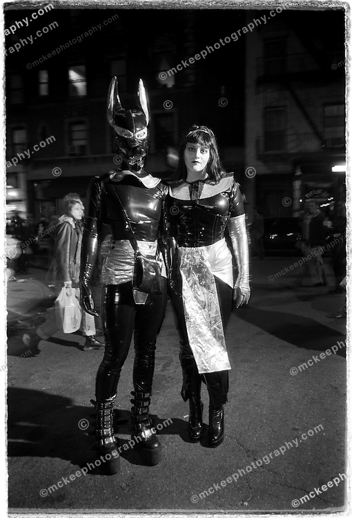 This couple strikes an Egyptian, manga, s & m theme on the streets of Greenwich Village, during Halloween, in NYC.
