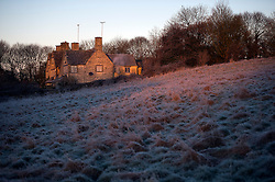 © Licensed to London News Pictures. A frost covered landscape at sunrise over Buford in Oxfordshire on December 29, 2014 as most of the UK woke to freezing temperatures.. Photo credit : Ben Cawthra/LNP