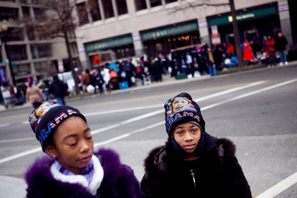 WASHINGTON - JANUARY 18: Children with Barack Obama hats mix with heavy crowds on Pennsylvania Avenue, near the White House, on January 18, 2009 in Washington, DC. Final touches are being put on preparations for President-elect Obama's swearing in in only two days. (Photo by Brendan Hoffman/Getty Images)