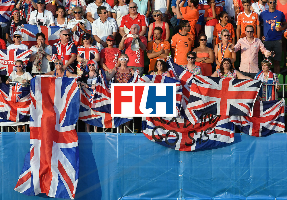 Britain and Netherlands fans cheer their teams during the women's Gold medal hockey Netherlands vs Britain match of the Rio 2016 Olympics Games at the Olympic Hockey Centre in Rio de Janeiro on August 19, 2016. / AFP / Pascal GUYOT        (Photo credit should read PASCAL GUYOT/AFP/Getty Images)