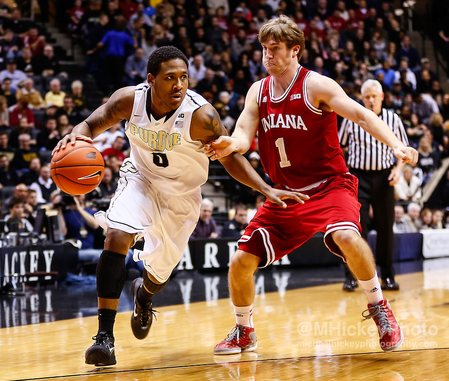 WEST LAFAYETTE, IN - JANUARY 30: Terone Johnson #0 of the Purdue Boilermakers dribbles the ball around Jordan Hulls #1 of the Indiana Hoosiers at Mackey Arena on January 30, 2013 in West Lafayette, Indiana. Indiana defeated Purdue 97-60. (Photo by Michael Hickey/Getty Images) *** Local Caption *** Terone Johnson; Jordan Hulls