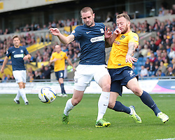 Oxford United's Sean Rigg is challenged by Southend United's John White - Photo mandatory by-line: Nigel Pitts-Drake/JMP - Tel: Mobile: 07966 386802 05/10/2013 - SPORT - FOOTBALL - Kassam Stadium - Oxford - Oxford United v Southend United - Sky Bet League 2