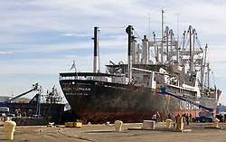 Crowds gather to watch the arrival of the Solon Turman,  to the newly re-opened dry docks located on Mare Island in Vallejo, Calif.  California Dry Dock Solutions was recently awarded a $3.1 Million contract from the U.S.Navy to dismantle two ships currently located in Suisun Bay.