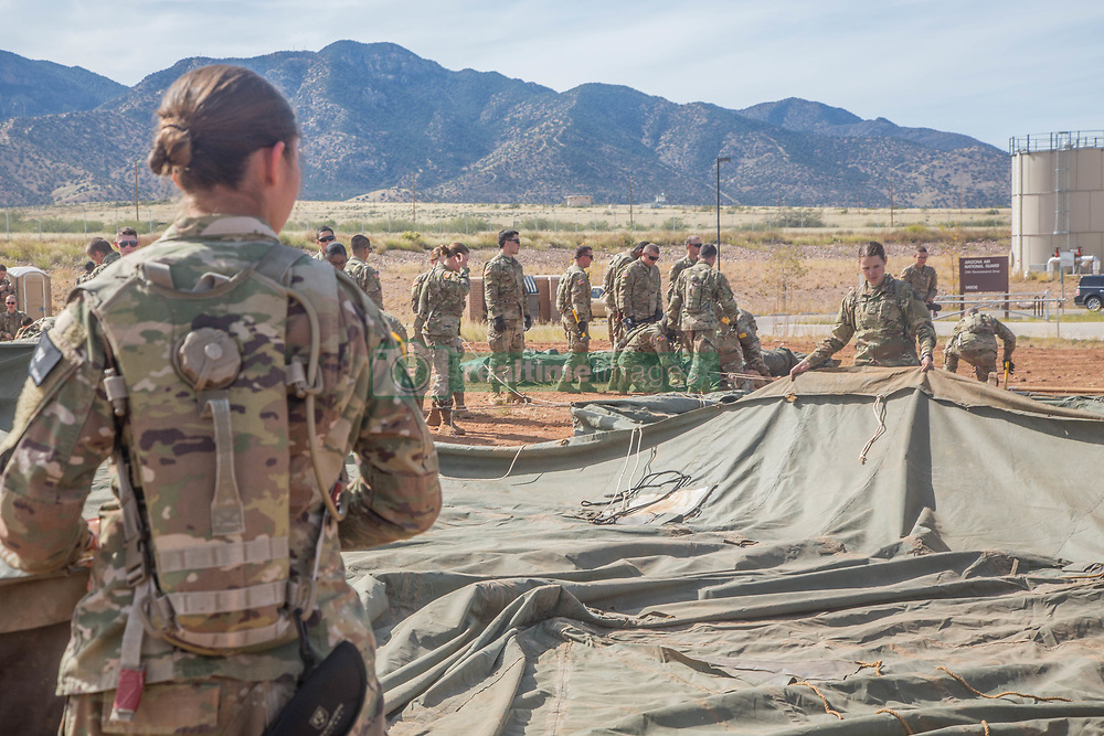 November 1, 2018 - Fort Huachuca, AZ, United States of America - U.S. Army soldiers from the 309th Military Intelligence Battalion and 305th Military Intelligence Battalion, set up tents to house the newly deployed troops November 1, 2018 in Fort Huachuca, Arizona. The troops are deploying to the U.S. - Mexico border by order of President Donald Trump to intercept the Honduran migrant caravan. (Credit Image: © Brandon Best via ZUMA Wire)