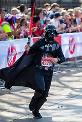 © Licensed to London News Pictures. 22/04/2018. London, UK. A runner dressed as Darth Vader from Star Wars passes the Cutty Sark in Greenwich during the Virgin Money London Marathon 2018. Photo credit: Rob Pinney/LNP