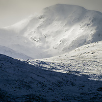 Light glancing over the snowdrifts on Stob a'Chorie Odhair