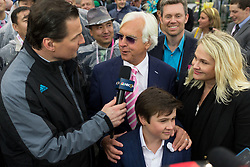 Abel Tasman trained by Bob Baffert, center is interviewed after winning the 143rd running of the Longines Kentucky Oaks at Churchill Downs May 5, 2017.