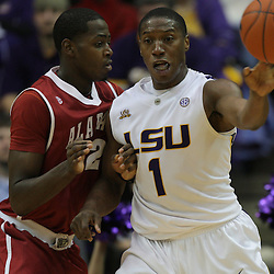 Jan 09, 2010; Baton Rouge, LA, USA; LSU Tigers forward Tasmin Mitchell (1) is guarded by Alabama Crimson Tide forward JaMychal Green (32) as he passes the ball during the second half at the Pete Maravich Assembly Center. Alabama defeated LSU 66-49.  Mandatory Credit: Derick E. Hingle-US PRESSWIRE