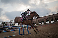 Aya Alajrami during a jump, she takes 3 lessons a week.