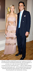 Model KATRINA SKEPPER and her husband COUNT ALLESANDRO GUERRINI-MARALDI, at a reception in London on 14th October 2002.	PEA 311