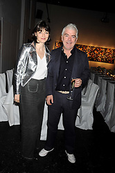 GEORGIA COLERIDGE and TIM BLANKS at an exhibition entitled 'Cut Flowers' by Robin Derrick held at 70a Silverthorne Road, London SW8 on 8th October 2008.