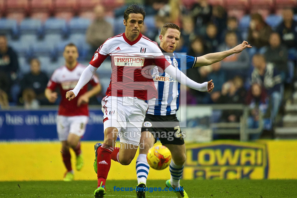 Bryan Ruiz of Fulham (left) and Adam Forshaw of Wigan Athletic (right) during the Sky Bet Championship match at the DW Stadium, Wigan<br /> Picture by Ian Wadkins/Focus Images Ltd +44 7877 568959<br /> 01/11/2014