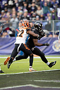 Baltimore Ravens rookie running back Gus Edwards (35) breaks a tackle attempt by Cincinnati Bengals cornerback William Jackson (22) as he runs for a third quarter touchdown that ties the score at 21-21 during the NFL week 11 regular season football game against the Cincinnati Bengals on Sunday, Nov. 18, 2018 in Baltimore. The Ravens won the game 24-21. (©Paul Anthony Spinelli)